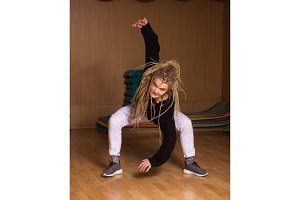 With dreadlocks is dancer in pose