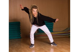 The dancer dances skilful hip-hop