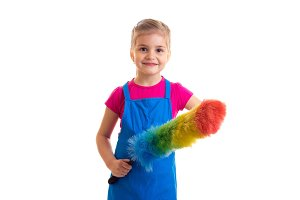 Girl in apron with duster doing