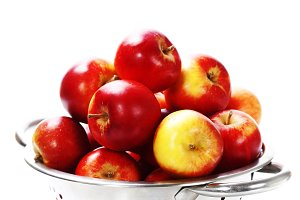 Fresh red apples in metal colander