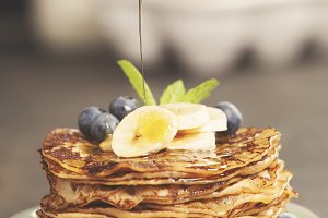 Homemade pancakes with fresh bananas