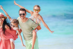 Family of four on beach vacation hav