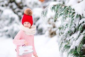 Cute little kid girl is going skate