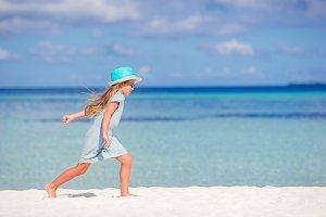 Adorable little girl during beach va