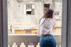 Young attractive woman on old balcon