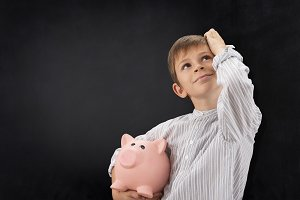 child with pig piggy bank and blackb