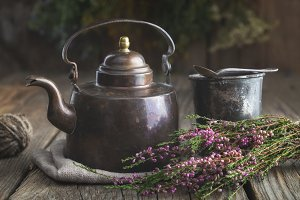 Teapot, tea cup, heather bunch.