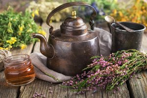 Teapot, tea cup and medicinal herbs.