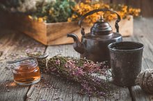 Teapot, tea cup, honey jar and herbs by  in Health