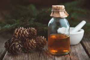 Pine oil, fir cones and branches.