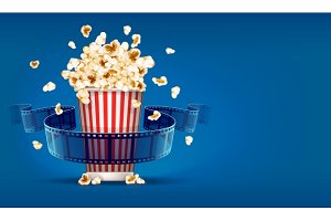 Popcorn for cinema and movie film tape on blue background