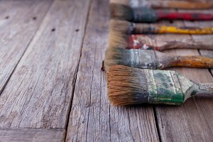 Old paintbrushes stained with paint