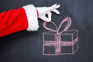 hand of santa claus with christmas g