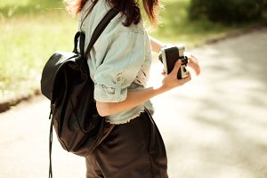 woman photographer with a backpack