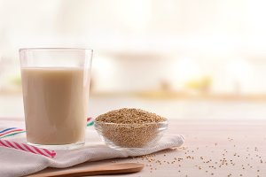 Quinoa drink and cereal grains front