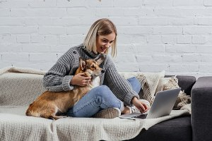 woman with welsh corgi dog