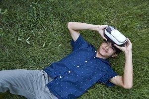 Asian man using the virtual reality