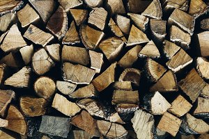 Stack pile of firewood texture patte