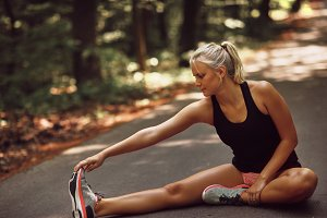 Fit woman warming up with stretches