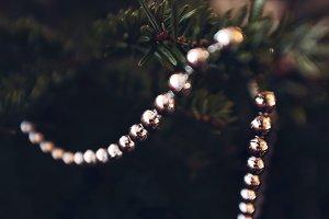 Silver New year garland on fir tree