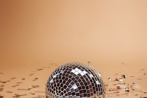 shiny silver disco ball and confetti