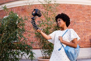 Tourist woman filming content