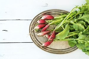 Bunch of fresh dirty garden radishes