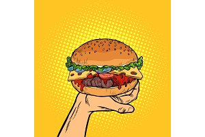 Burger on hand. fast food