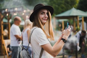 girl takes photo on smartphone