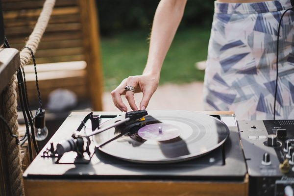 Technology Stock Photos: EVA.studio - girl dj playing vinyl records