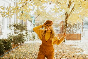 Model Goofing Off Around Fall Leaves