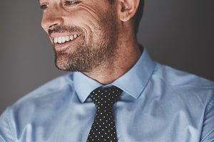 Smiling young businessman standing a