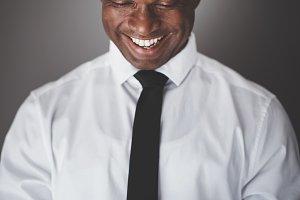 Smiling African businessman using hi