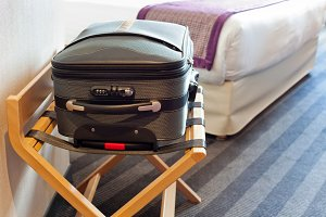 Hotel room with a suitcase