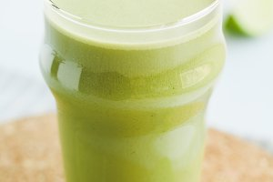 A glass with a green smoothie