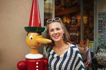 smiling woman near tourist souvenir