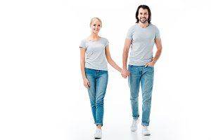 Lovely couple in grey t-shirts holdi