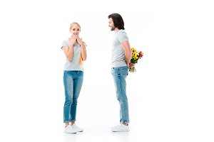 shocked girl and man hiding bouquet