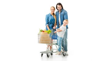 Happy family with shopping cart and