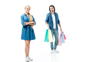 Man with shopping bags and happy wom