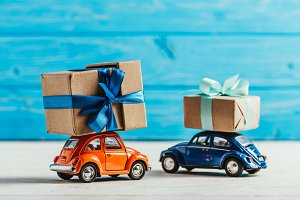 close-up shot of toy cars with gift