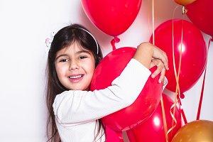 Baby Girl Holding Balloons celebrati
