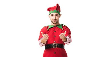 man in christmas elf costume with ou