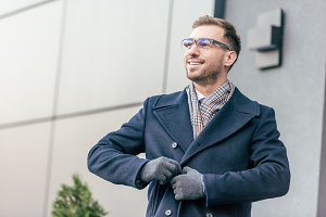 adult smiling handsome man in glasse