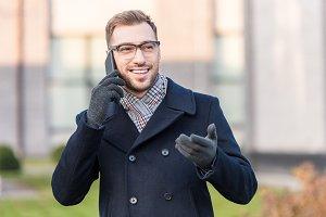 happy smiling man talking on smartph