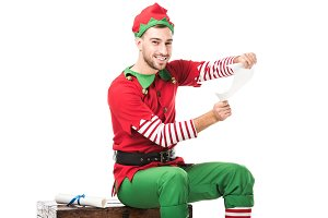 smiling man in christmas elf costume