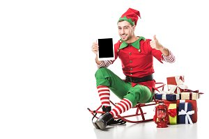 man in christmas elf costume sitting