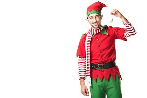 man in christmas elf costume holding