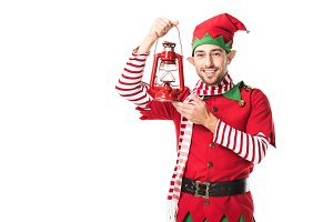cheerful man in christmas elf costum