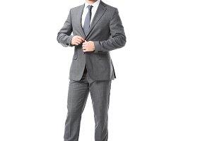 adult businessman in glasses fasteni